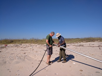 John Anderson and Chris Odezulu rigging up for vibracoring